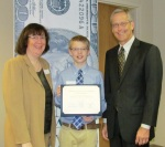 Marybeth Foster and John Sorensen present Sam Jones With 2012 Money Smart Kid Certificate